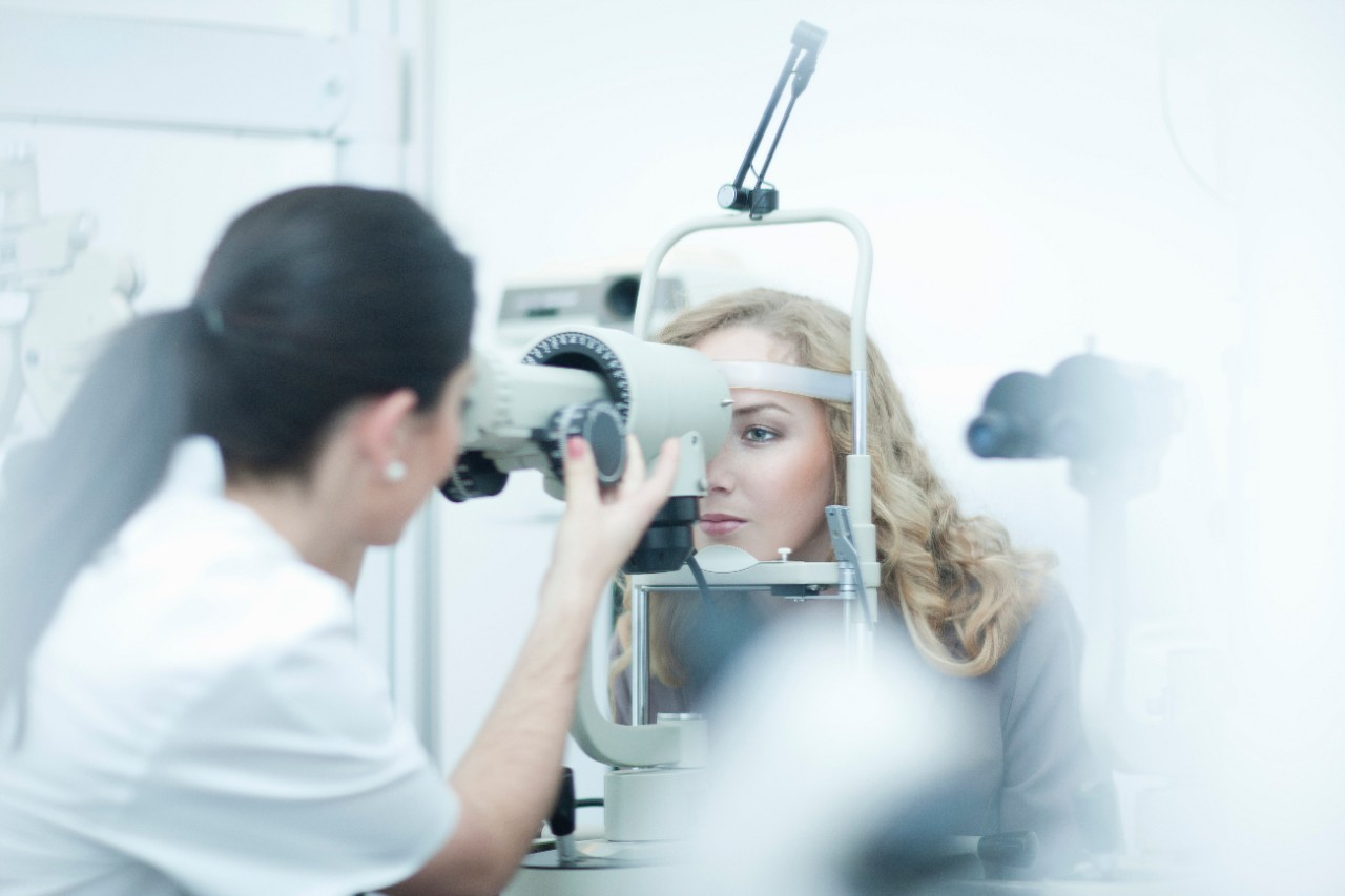 Healthcare - Young woman having eyes tested